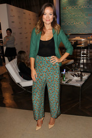Olivia Wilde looked cool in Gucci print pants and a green blazer when she visited the Variety Studio.