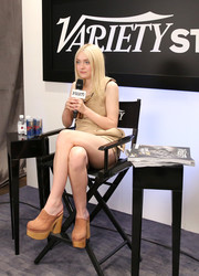Dakota Fanning visited the Variety Studio wearing a pair of heavy-looking tan clogs.
