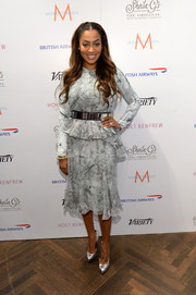 La La Anthony showed her more conservative side in a long-sleeve subtle-print peplum dress during her visit to the Variety Studio.