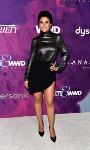 Emmanuelle Chriqui tied her look together with a pair of black cutout pumps.