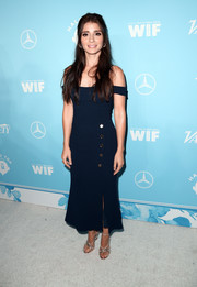 Shiri Appleby styled her frock with gold crisscross-strap heels by Stuart Weitzman.
