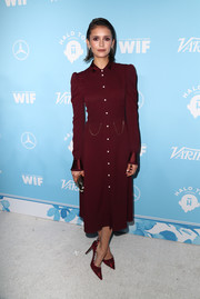 Nina Dobrev channeled the '40s in a long-sleeve maroon shirtdress by Altuzarra at the Variety and Women in Film pre-Emmy celebration.