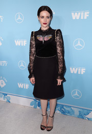 Claire Foy coordinated her look with a pair of black multi-strap sandals.