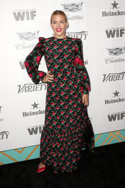 Busy Philipps paired her gown with fuchsia satin pumps by Malone Souliers.