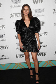 Alison Brie went for a bold silhouette in a black Dundas wrap dress with puffed sleeves and a ruffled hem at the Variety and Women in Film pre-Emmy celebration.