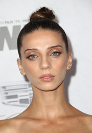 Angela Sarafyan styled her hair into a tight top knot for the Variety and Women in Film pre-Emmy celebration.