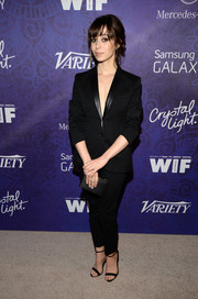 Cristin Milioti paired black ankle-strap sandals with her suit for a more feminine finish.