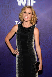 Julie Bowen accessorized with an ultra-elegant black satin clutch with bedazzled edges when she attended the Variety and Women in Film Emmy nominee celebration.