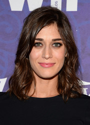 Lizzy Caplan opted for a casual wavy 'do when she attended the Variety and Women in Film Emmy nominee celebration.