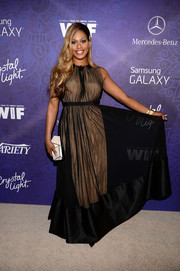 Laverne Cox contrasted her classic gown with a modern white geometric clutch.