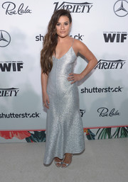 Lea Michele complemented her dress with a pair of silver evening sandals by Alexa Wagner.