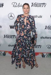 Amanda Peet covered up her figure in a long-sleeve, handkerchief-hem print dress for the Variety and Women in Film pre-Emmy celebration.