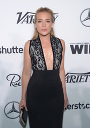 Piper Perabo paired an elegant black and silver box clutch with a plunging gown for the Variety and Women in Film pre-Emmy celebration.