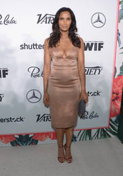 Padma Lakshmi styled her gorgeous dress with purple satin ankle-strap sandals.
