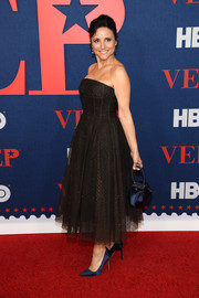 Julia Louis-Dreyfus styled her frock with navy satin pumps.