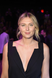 Maria Sharapova styled her hair into a loose chignon for the Vera Wang fashion show.
