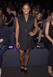 Simone Biles complemented her frock with black broad-strap pumps.