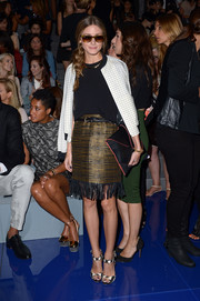 Olivia Palermo teamed a fringed brown skirt with a black top and a checkered zip-up jacket for the Vera Wang fashion show.