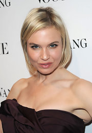 Renee pulls this cute bob away from her face with a simple side part.