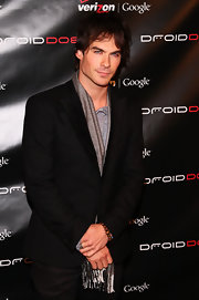 Ian looks chic with a long gray scarf under his suit jacket.