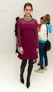 Hilary Rhoda looked so city-chic in her over-the-knee boots and cranberry dress.