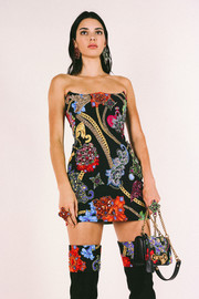 Kendall Jenner went matchy-matchy with this bag, dress, and boots combo at the Versace Men's Spring 2019 show.
