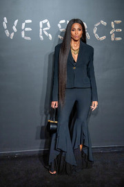 Ciara completed her ensemble with a black leather purse.