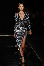 Irina Shayk donned a monochrome mixed-print dress for her walk on the Versace runway.