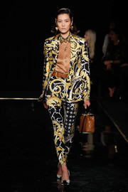 Liu Wen was a rockstar in a baroque-print pantsuit at the Versace runway show.