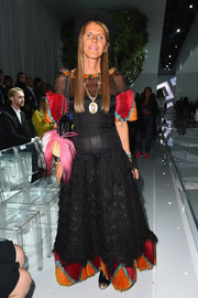 Anna dello Russo was equal parts fun and glam in a black gown with a colorful hem, neckline, and sleeves during the Versace show.