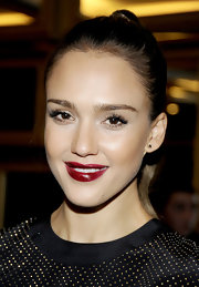Jessica Alba wore a deep, rich ruby lipstick at the Versace for H&M fashion event in NYC.