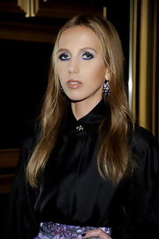 Allegra Versace complemented her eyes with vibrant purple and soft lavender shadows and lots of mascara for the Versace for H&M fashion event.