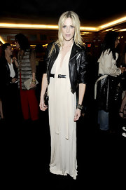 Byrdie Bell toughened her ethereal white gown with a black biker jacket.