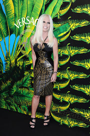 Donatella Versace topped off her back and gold studded frock with black strappy sandals.