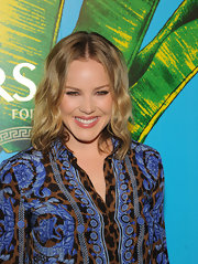 Abbie Cornish wore her medium-length bob in casual waves at the Versace for H&M fashion event.