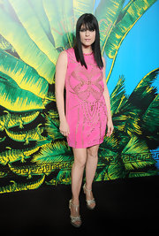 Selma Blair opted to wear a bright piece from the Versace for H&M Fashion Event. The new mother stepped out in a hot pink shift dress with a signature gold studded design. Metallic platform pumps and a sleek straight 'do topped off her style.