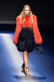 Natasha Poly walked the Versace show looking lavish in an ombre fur coat.