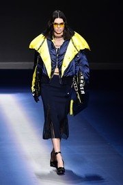 Kendall Jenner was tough-glam in a bulky two-tone jacket while walking the Versace runway.