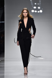 Gigi Hadid walked the Atelier Versace runway wearing what must have been the sexiest pantsuit ever created!