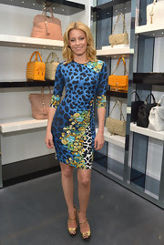 Elizabeth Banks showed off her wild side with a bright blue leopard-print dress that featured fun floral detailing.