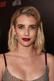 Emma Roberts complemented her dress with a pair of gemstone drop earrings by Irene Neuwirth.