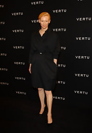 Tilda stepped onto the red carpet of the Constellation launch in Milan wearing a black drapy shirt dress.