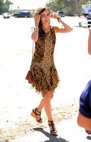 Camilla Belle accessorized her gold and yellow floral dress with brown wedges and a supple leather bag complete with a chain shoulder strap.