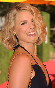 Ali Larter wore her medium-length bob in soft waves at the Veuve Clicquot Polo Classic. To try her look at home, simply curl two-inch sections of hair with a large-barreled curling iron, tousle waves and mist with a product like Fekkai Coiff Bouffant Lifting & Texturzing Spray.