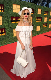Rachel Zoe accessorized her all-white outfit with a classic quilted leather bag.