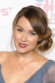 Lauren Conrad channeled old-Hollywood Glamour while attending VH1's Save the Music. She completed her elegant look with deep red lipstick.