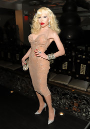 Amanda Lepore showed off her love of Vegas show girls in this bedazzled nude halter dress. She added even more glitter and gleam with a pair of sparkling pumps.