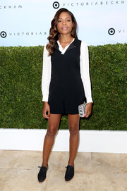 Naomie Harris went preppy in a black Victoria Beckham x Target romper teamed with a long-sleeve white blouse when she attended the collection's launch.
