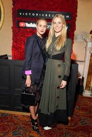 Elisabeth von Thurn und Taxis accessorized with a boxy black purse at the Victoria Beckham x YouTube Fashion & Beauty afterparty.