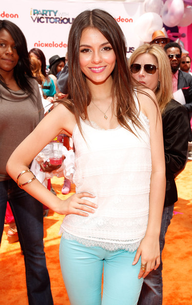 Victoria Justice Gold Bracelet [iparty with victorious,icarly,event,premiere,long hair,jeans,brown hair,layered hair,smile,victoria justice,orange carpet,casts,los angeles,nickelodeon,the lot,premiere,primetime tv event]